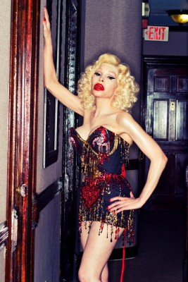 """The Love Warrior"", designed by Maison Moginot (France) with help from Mr. Pearl, is dripping with jewels. Model: Amanda Lepore"