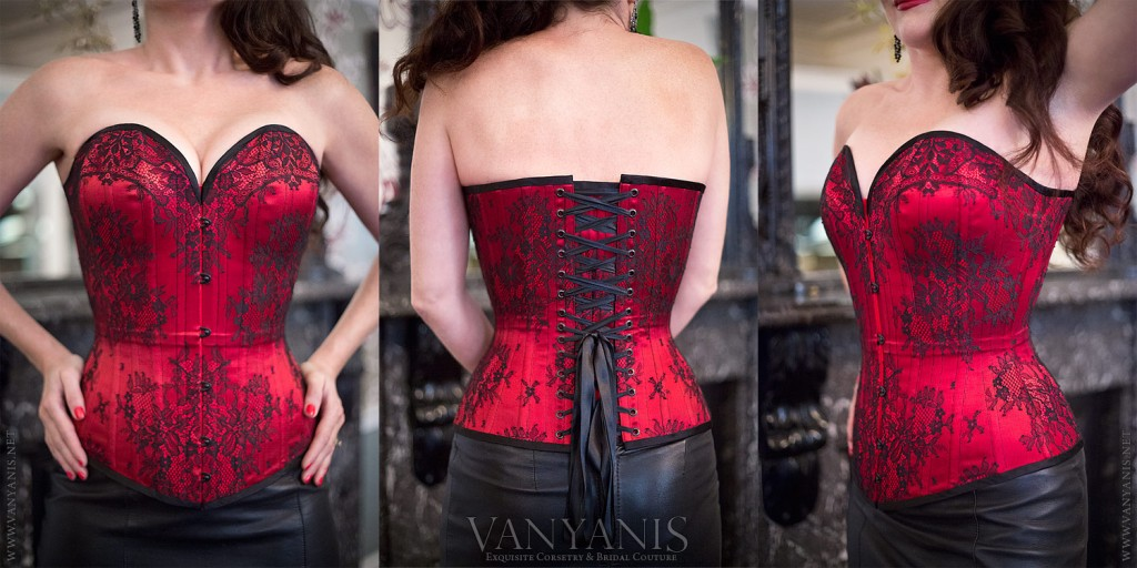 While this may look like black lace appliqué, it's actually a mind-bogglingly flawless match job by Lowana of Vanyanis. The motifs of leavers lace were secured to each panel of red satin coutil before being matched at the seams. All hardware is finished in a complementary black.