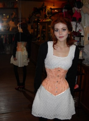 Kitty in her custom peach underbust Corset from Lace Embrace Atelier, which offers back support, lifts the stomach and liver, and features a concealed flap to access her bag.
