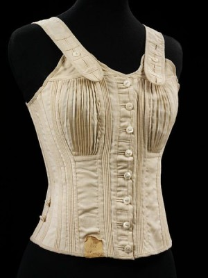 1890 girls' 'Jaeger' corset, one of the corsets kept by the V&A. It shows buttons down the front, posture-corrective shoulder straps, and fine pleats in the front to accommodate a developing bust throughout adolescence.