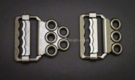 Two variations of metal sliders for fan-lacing (suppied by Vena Cava Design)