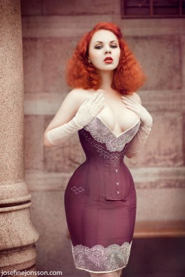 This gorgeous plunge corset dress embellished with lace and crystals was designed by Viola Lahger (Sweden). Model: Insanitea Photo: Josephine Jonsson.