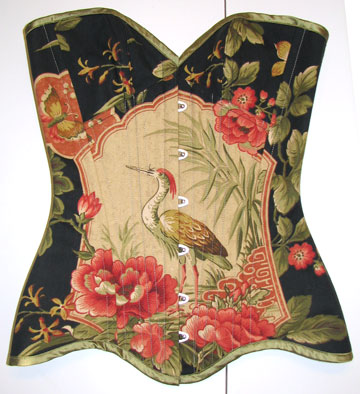 Electra Designs was one of the first corset makers to have perfected the pattern matching technique, particularly large, asymmetric motifs such as this crane themed overbust.
