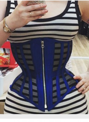 A happy client snaps a selfie of her custom mesh underbust from Mitchell Dane (MDC Designs) with a front zip closure.
